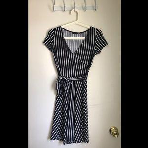 Black and white striped faux wrap dress